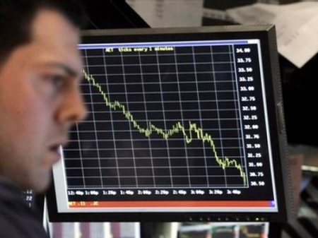 trader looks at dow jones chart